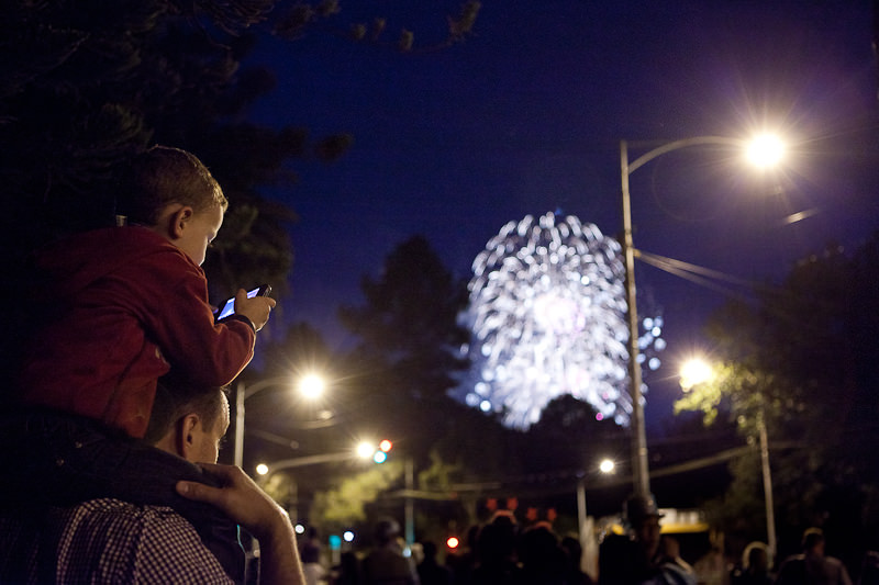 Mark Lobo Photography - Melbourne - Bored Kid at New Years Eve Fireworks